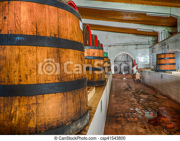 Wine barrels stacked in the old cellar of the winery. - csp41543800