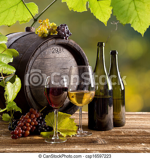 Wine bottle and glasses on wooden table - csp16597223