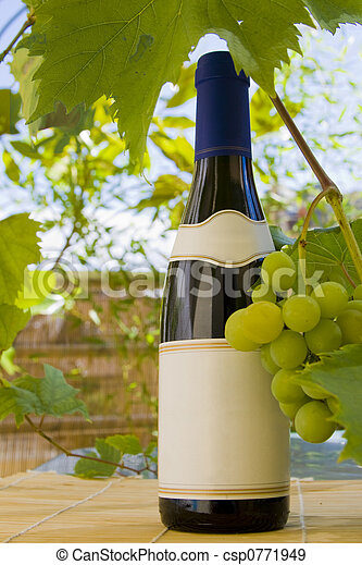 Wine bottle and grapes. - csp0771949