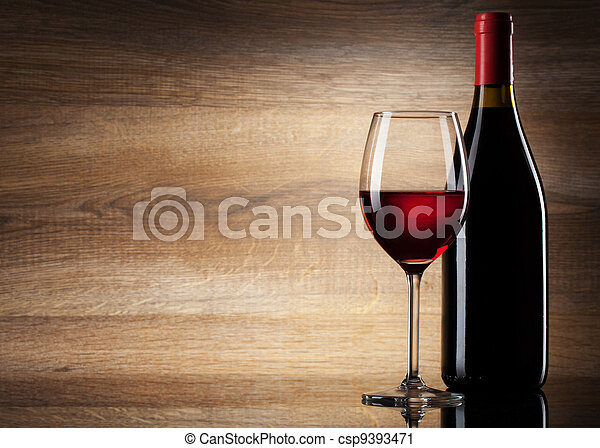 Wine glass and Bottle on a wooden background - csp9393471