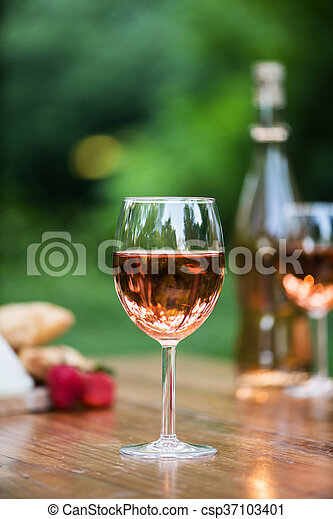 Wine glass is the center of attention in the pretty outdoor stock