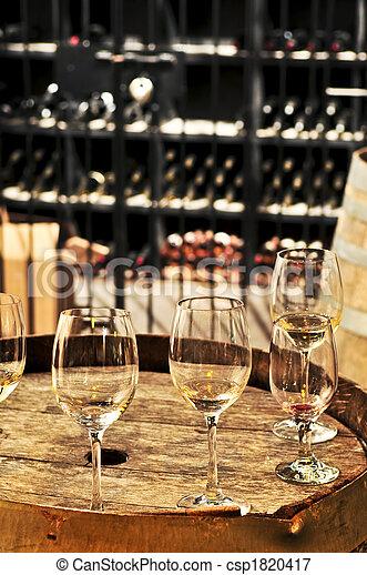 Wine  glasses and barrels - csp1820417