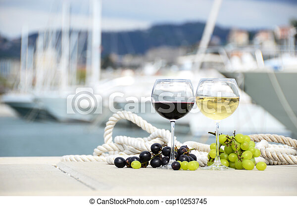 Wineglasses and grapes on the yacht pier of La Spezia, Italy - csp10253745