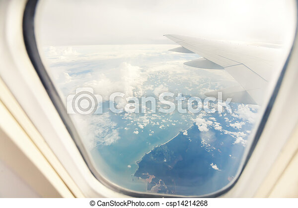 wing of airplane - view through the window - csp14214268