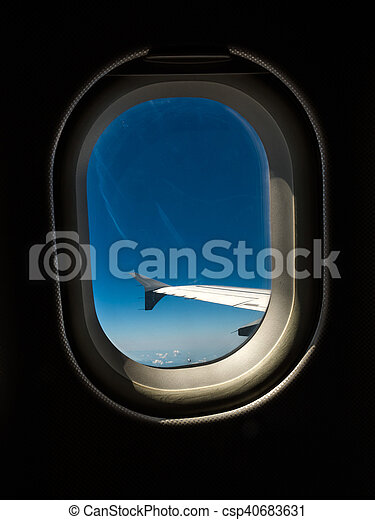 wing of an airliner against blue sky - csp40683631