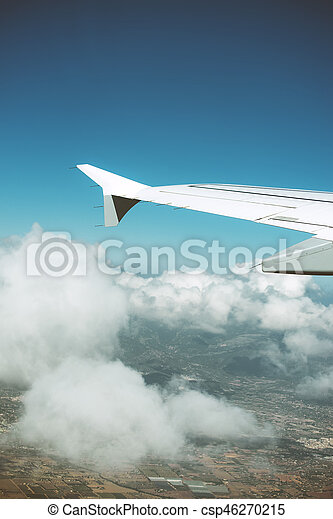 Wing of an airplane, view from window. - csp46270215