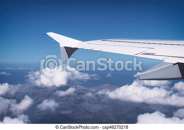 Wing of an airplane, view from window. - csp46270218