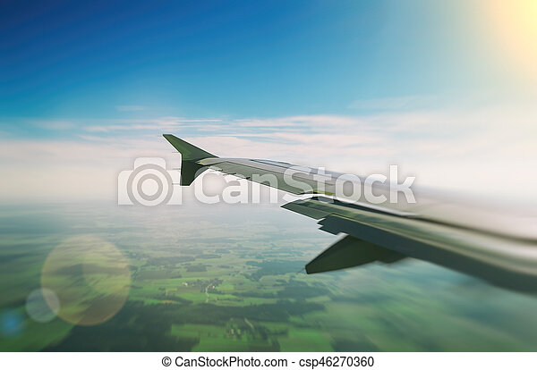 Wing of an airplane, view from window. - csp46270360