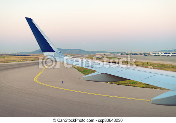 Wing of an airplane, view from window. - csp30643230