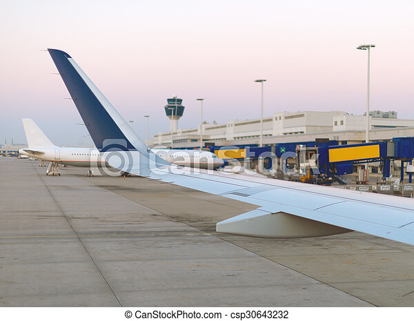 Wing of an airplane, view from window. - csp30643232