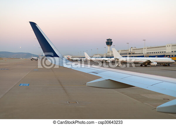 Wing of an airplane, view from window. - csp30643233
