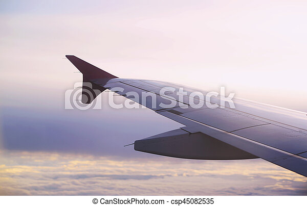 Wing of the plane on blue sky background - csp45082535