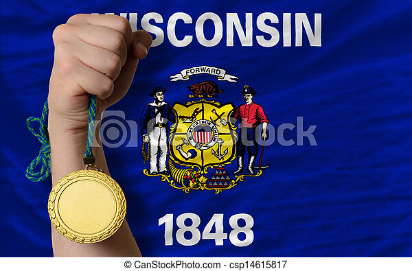 Winner holding gold medal for sport and flag of us state of wisconsin - csp14615817