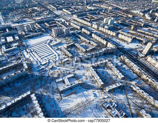Winter aerial view to residential area in Kharkiv, Ukraine - csp77935027