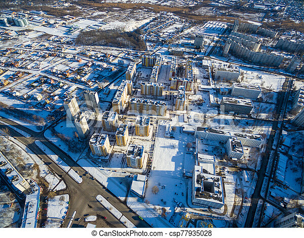 Winter aerial view to residential area in Kharkiv, Ukraine - csp77935028
