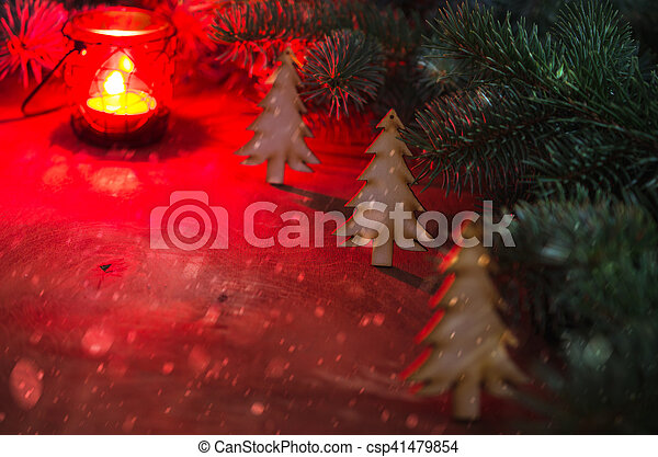 winter christmas backgroun christmas tree burning red candle snow falling effect dark image selective focus
