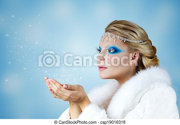 Winter Christmas Girl. Beautiful Woman Blowing Snow - csp19016318