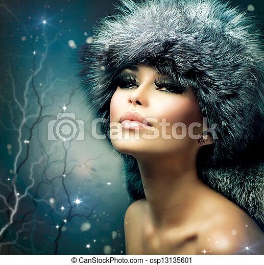 Winter Christmas Woman Portrait. Beautiful Girl in Fur Hat - csp13135601