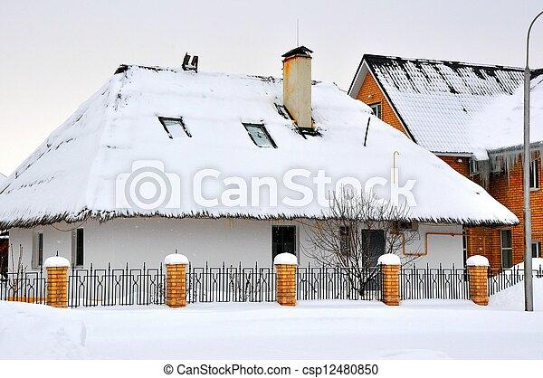 Winter cottage in the village - csp12480850