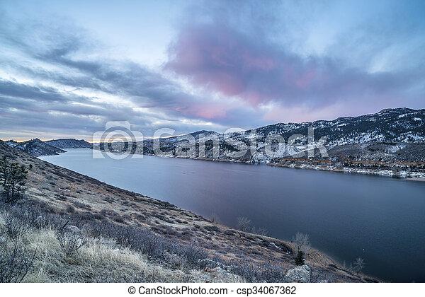 winter dawn over mountain lake - csp34067362