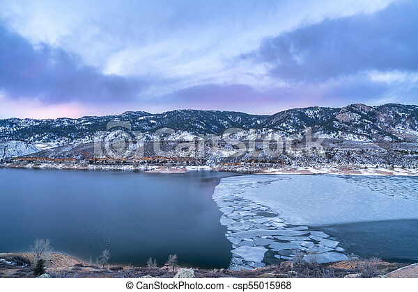 winter dawn over mountain lake - csp55015968