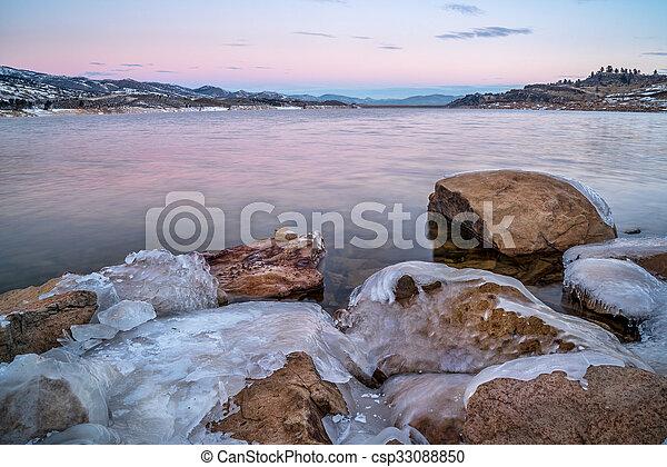 winter dawn over mountain lake - csp33088850