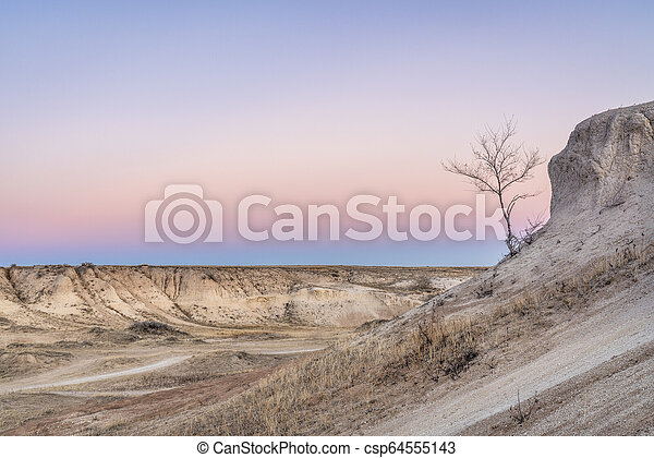 Winter dusk over badlands - csp64555143