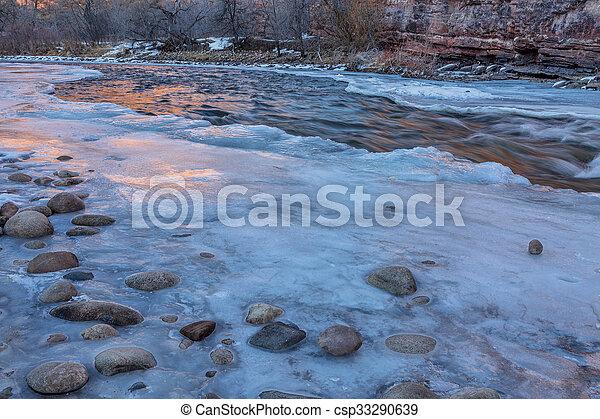 winter dusk over mountain river - csp33290639