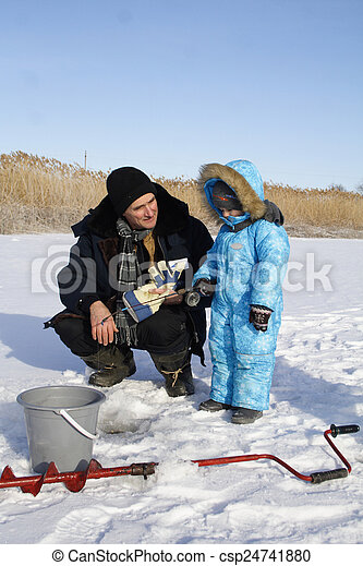 Winter fishing with grandpa - csp24741880