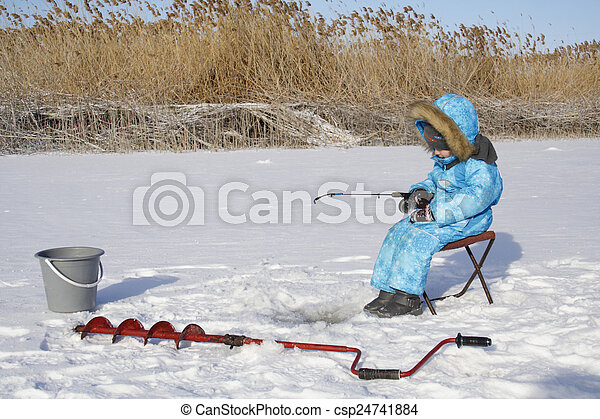 Winter fishing Young fisherman - csp24741884