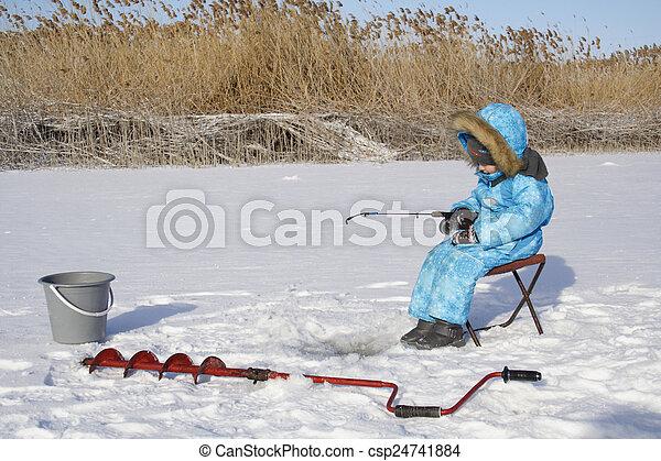 Winter fishing Young fisherman - csp24741884