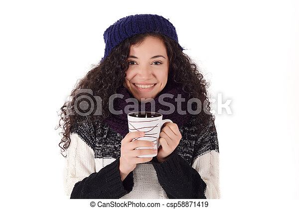 Winter girl drinking coffee to warm up. - csp58871419