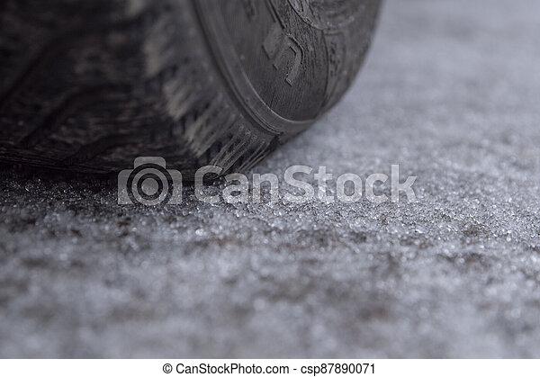Winter hail on the road. Car wheel. - csp87890071