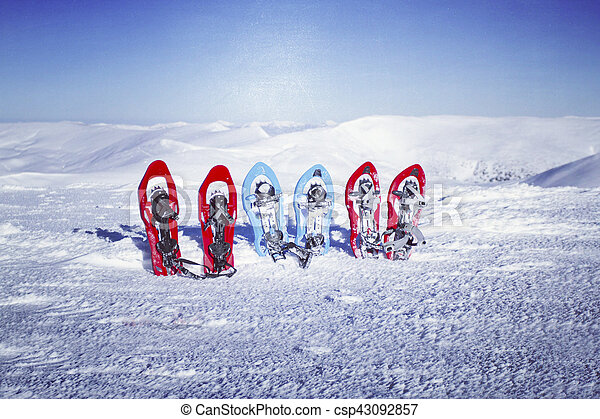 Winter hiking in the mountains on snowshoes with a backpack and tent. - csp43092857