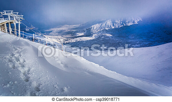 Winter in the mountains at sunrise - csp39018771