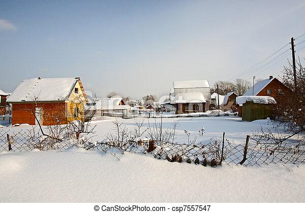 Winter in village - csp7557547