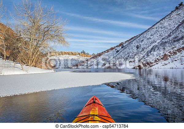 winter kayak paddling in Colorado - csp54713784