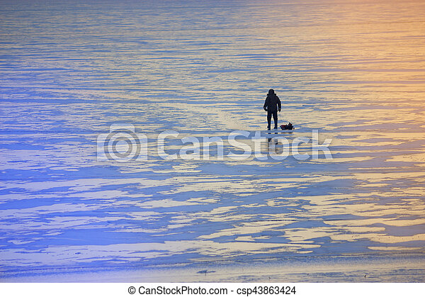 winter landscape fisherman on the river - csp43863424