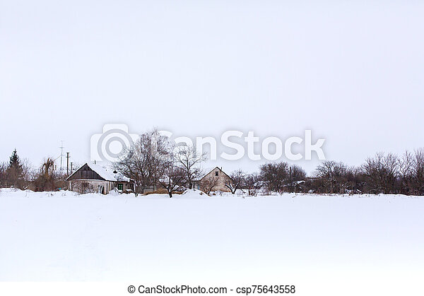 Winter landscape in the village. - csp75643558