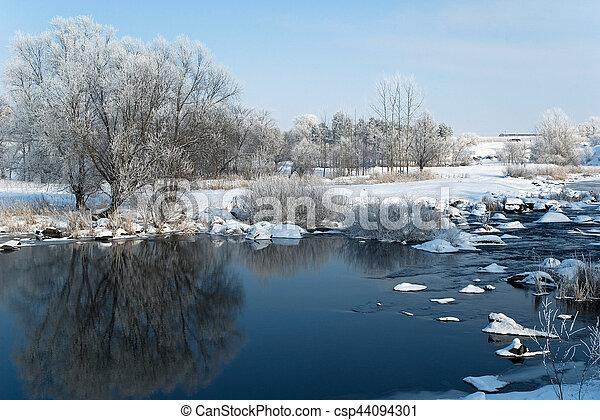 Winter landscape on the river - csp44094301