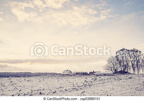 Winter landscape with a small farm house - csp53889101