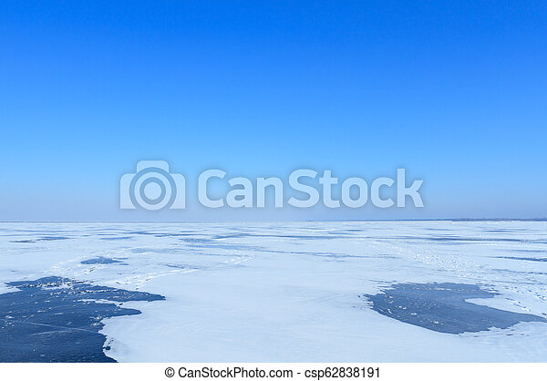 Winter landscape with sea and blue sky - csp62838191