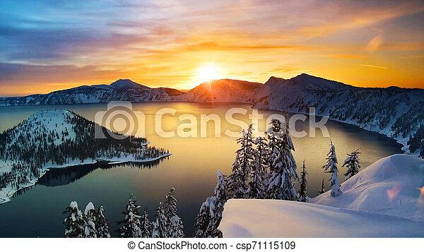 Winter, mountain lake at sunrise - csp71115109