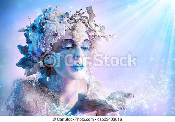 Winter portrait blowing snowflakes - csp23403616