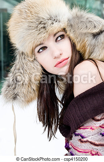 winter portrait of young woman in fur hat - csp4150200