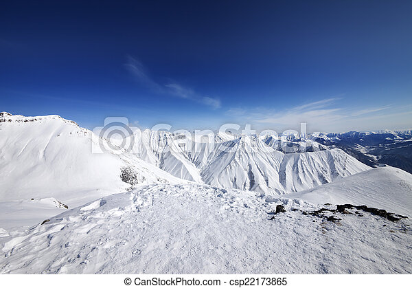 Winter snowy mountains and blue sky - csp22173865