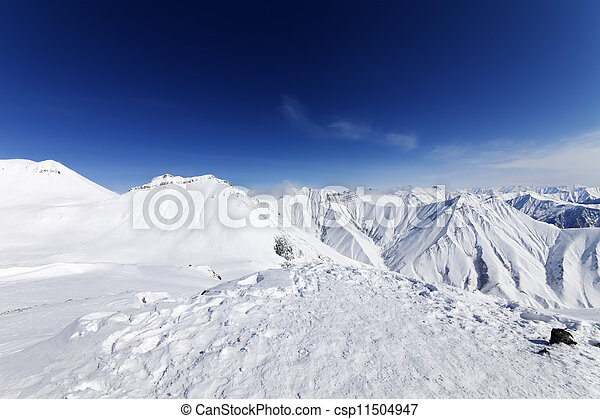 Winter snowy mountains and blue sky - csp11504947