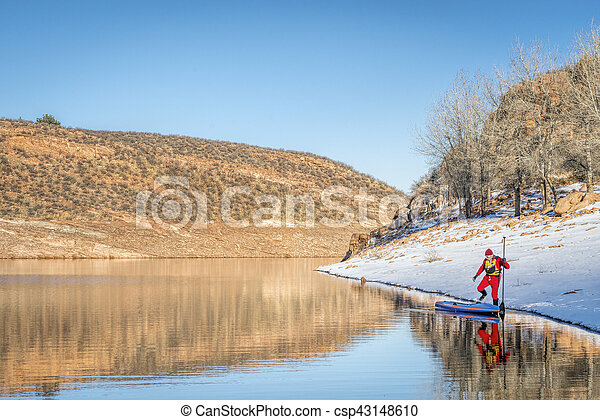winter stand up paddling in Colorado - csp43148610