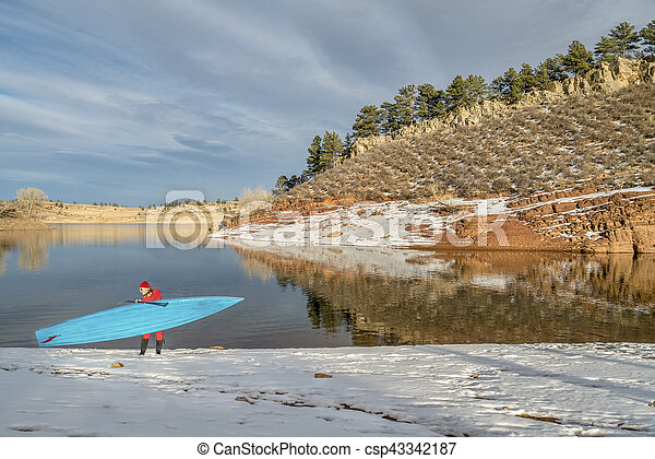 winter stand up paddling in Colorado - csp43342187