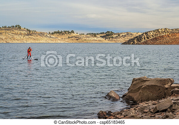 winter stand up paddling in Colorado - csp65183465